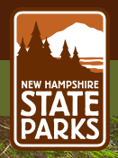 """Image of moutain with sharp peak in white with trees in brown in front with """"New Hampshire State Parks"""" written at bottom."""